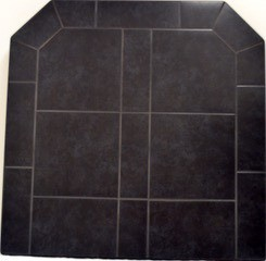 ComfortBilt Mill Black Hearth Pad designed for our pellet stove burning wood pellets.